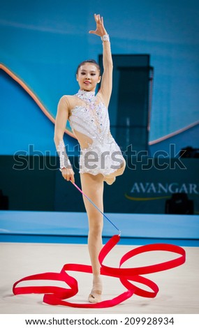 KYIV, UKRAINE - AUGUST 30, 2013: Senyue Deng of China performs during 32nd Rhythmic Gymnastics World Championship (Individual All-All-Around competition)