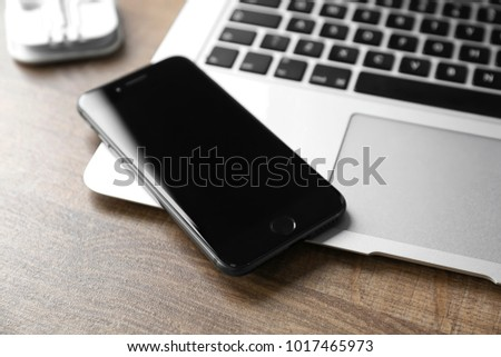KYIV, UKRAINE - DECEMBER 5, 2017: iPhone 8 Space Grey with blank screen on laptop