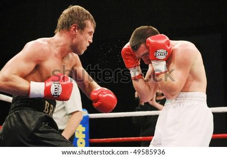 KYIV, UKRAINE - FEB 21:  Ukrainian Valeriy Brazhnyk (L) is on the attack against Georgian George Ungiadze for the minor WBC CIS  welterweight champion title on Feb 21, 2008 in Kyiv, Ukraine