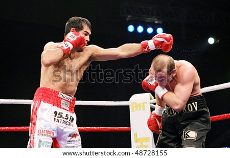 KYIV, UKRAINE - FEBRUARY 21: Julio Cesar Dominguez fight(L) against Vyacheslav Uzelkov during a bout for the WBA light heavyweight Intercontinental Champion title on Feb 21, 2008 in Kyiv, Ukraine