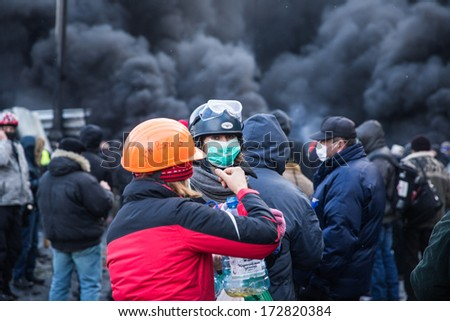 KYIV, UKRAINE - JAN 23: Women on the occupying street on the demostration during anti-government protest Euromaidan on January 23, 2014, in center of Kiev, Ukraine