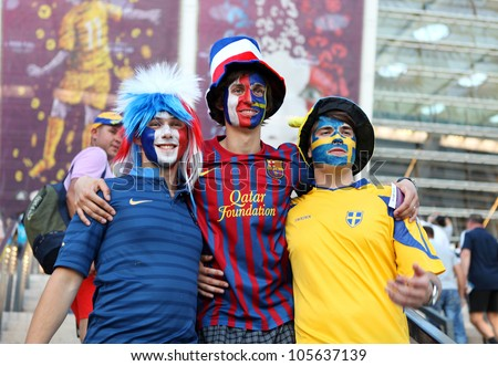 KYIV, UKRAINE - JUNE 19 2012: Football fans on Olympic stadium before start match Sweden- France, Group D.  EURO 2012 in Kyiv, 19 june 2012. - stock photo