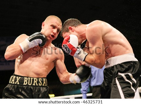 KYIV, UKRAINE - JUNE 14: Ukrainian Maxim Bursak (L) fights with his Italian opponent Giovanni de Carolisa during the boxing tournament on June 14, 2008 in Kyiv, Ukraine