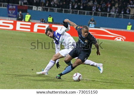 KYIV, UKRAINE - MARCH 10: Artem Milevskiy of Dynamo Kyiv (L) fights for a ball with Vincent Kompany of Manchester City during their UEFA Europa League game on March 10, 2011 in Kyiv, Ukraine