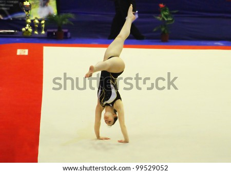 "KYIV, UKRAINE - MARCH 31: Carmen Horvat (Slovenia) does exercises at sporting gymnastics ""Cup of Olympic Champion Stella Zakharova"" on March 31, 2012 in Kyiv, Ukraine"
