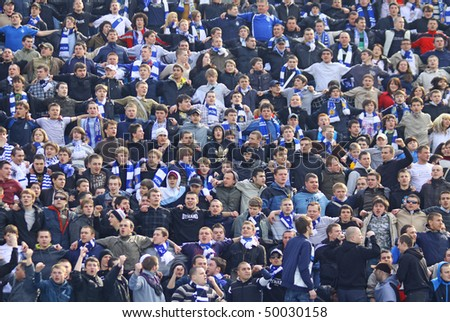 KYIV, UKRAINE - MARCH 28: Dynamo Kyiv team supporters watch the football game of Ukraine Championship against Metalist Kharkiv on March 28, 2010 in Kyiv, Ukraine