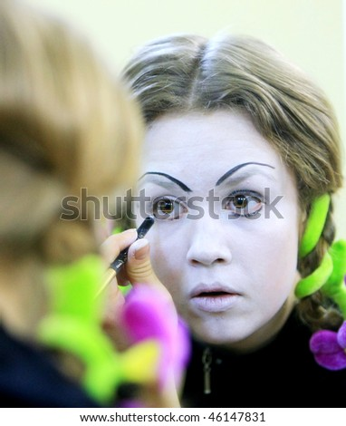 """KYIV, UKRAINE - MARCH 11: mime puts his makeup on getting ready for his show called """"Marcel Marceau's Successors"""" backstage at the Actor's House on March 11, 2008 in Kyiv, Ukraine"""
