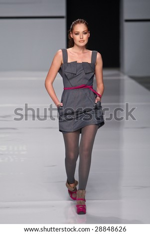 """KYIV, UKRAINE - March 13, 2009: Model walks the runway during Fashion Show by """"Anna Bublik Exclusive collection"""" as part of Ukrainian Fashion Week, March 13, 2009 in Kyiv, Ukraine."""
