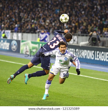 KYIV, UKRAINE - NOVEMBER 21: Gregory van der Wiel of FC PSG (L, #23) fights for a ball with Dudu of FC Dynamo Kyiv (R, #99) during their UEFA Champions League game on November 21,2012 in Kyiv, Ukraine