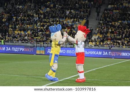 KYIV, UKRAINE - NOVEMBER 11: Slavek and Slavko, the UEFA Euro 2012 mascots playing during friendly game between Ukraine and Germany at NSK Olimpic stadium on November 11, 2011 in Kyiv, Ukraine