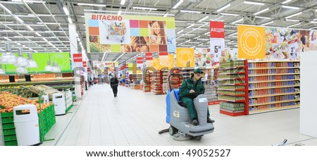 KYIV, UKRAINE - NOVEMBER 13: Worker in supermarket during preparation for the opening of the first store of OK supermarket network on November 13, 2007 in Kyiv, Ukraine.