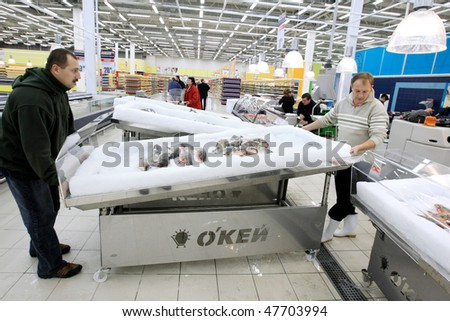 KYIV, UKRAINE - NOVEMBER 13: Workers prepare for the grand opening of OK supermarket network on November 13, 2007 in Kyiv, Ukraine.