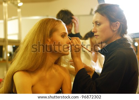 KYIV, UKRAINE - OCT. 16: Model getting ready for fashion show during Ukrainian Fashion Week, October 16, 2011 in Kyiv, Ukraine. - stock photo