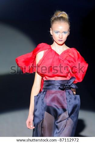 "KYIV, UKRAINE - OCT. 14: Model walks the runway during Fashion Show by ""BEKh"" as part of Ukrainian Fashion Week, October 14, 2011 in Kyiv, Ukraine. - stock photo"