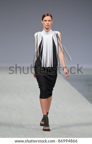 "KYIV, UKRAINE - OCT. 14: Model walks the runway during Fashion Show by ""LITKOVSKAYA&q uot; as part of Ukrainian Fashion Week, October 14, 2011 in Kyiv, Ukraine. - stock photo"