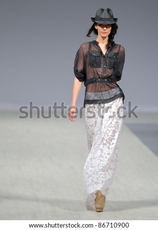 KYIV, UKRAINE - OCT. 14, 2011: Model walks the runway during Fashion Show by Tetiana ZEMSKOVA - Olena VOROZHBIT as part of Ukrainian Fashion Week, October 14, 2011 in Kyiv, Ukraine.
