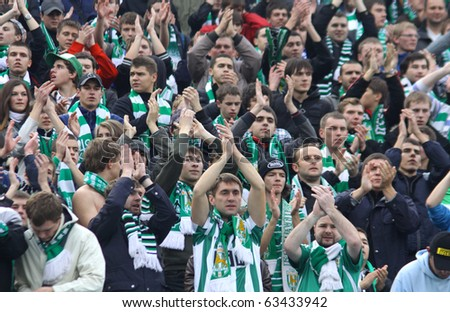 KYIV, UKRAINE - OCTOBER 16: FC Karpaty Lviv team supporters show their support during Ukraine Championship game against FC Dynamo Kiev on October 16, 2010 in Kyiv, Ukraine