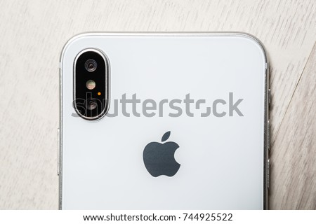 KYIV,UKRAINE-9 OCTOBER,2017:Iphone X mobile phone in close up on white wooden background.Latest Apple Iphone 10 mobile phone.Illustrative editorial.Iphone10 macro.Newest Iphone X cell phone top view