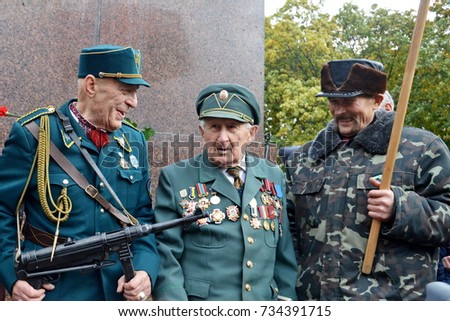 KYIV, UKRAINE - OCTOBER 14, 2017: Veterans of the UPA during a rally mark the 75th anniversary of the creation of the Ukrainian Insurgent Army (UPA) #734391715
