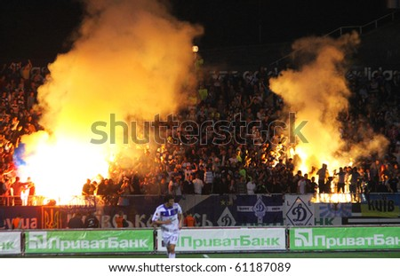 KYIV, UKRAINE - SEPTEMBER 16: Dynamo Kyiv ultras (ultra supporters) burn a flares during UEFA Europa League game against Bate on September 16, 2010 in Kyiv, Ukraine