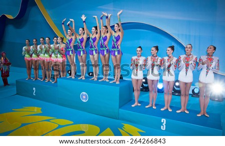 KYIV, UKRAINE - SEPTEMBER 1, 2013: Team of Italy (L), Spain (C) and Ukraine (R), the medallists of Group Apparatus Final competition of 32nd Rhythmic Gymnastics World Championship in Kyiv