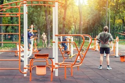 Kyiv,Ukraine - September 28th, 2019: People making sport exercises and training at public outdoor gym area at city park. Healthy lifestyle concept