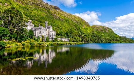 Photo of  Kylemore Abbey, beautiful castle like abbey reflected in lake at the foot of a mountain. Benedictine monastery founded in 1920, in Connemara, Ireland