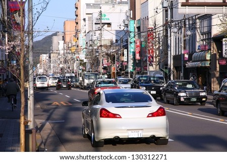 KYOTO, JAPAN - APRIL 14: Cars drive in heavy traffic on April 14, 2012 in Kyoto, Japan. With 589 vehicles per capita, Japan is among most motorized countries worldwide, which causes heavy traffic.