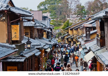 KYOTO, JAPAN - APRIL 10 2012: Tourists wander a famous street, Sannen-Zaka, in Kyoto on April 10 2012.  The street is located in the heart of Kyoto attractions. Many souvenir shops can be found here.