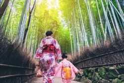 Kyoto, Japan Culture Travel - Asian traveler wearing traditional Japanese kimono walking in Arashiyama Bamboo Forest Grove in the old town of Kyoto, Japan.