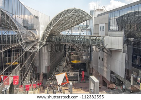KYOTO,JAPAN-JULY 16:Kyoto station on July 16,2011 in Kyoto, Japan.The current Kyoto Station opened in 1997.The building, is about 70 meters high and 470 feet long,displays many futuristic features.
