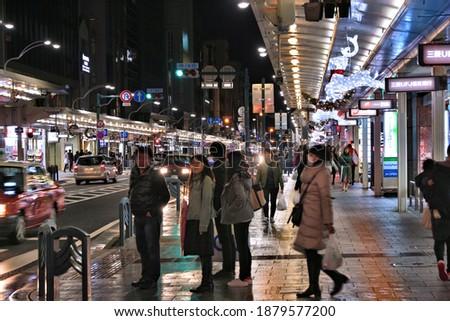 KYOTO, JAPAN - NOVEMBER 27, 2016: People shop at Shijo Dori in Kyoto, Japan. Kyoto is a major city with population of 1.5 million.