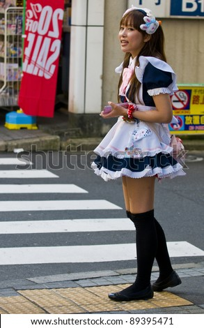 KYOTO,JAPAN - OCT 29 : Japanese girl dressed as a maid promoting \