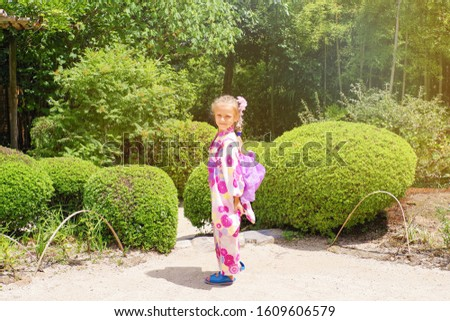 Kyoto, Japan Portrait of girl dressed as Geisha in traditional dress, Kyoto, Japan.European girl dressed in Japanese kimano walks in the Japanese garden. Japanese garden, Japanese culture.