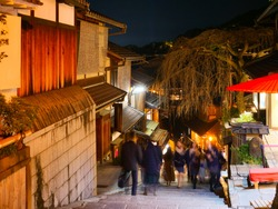 Kyoto, Japan:  Sannenzaka Slope is a popular place for many tourists to visit.  Traditional wooden houses/buildings, machiya, teahouses and shops