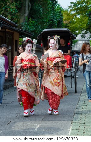 KYOTO, JAPAN-SEPT 5: Traditional geishas on a street in Kyoto on Sept.5, 2009. There are about 2,000 geishas in Japan today, preserving ancient arts and customs in modern life.