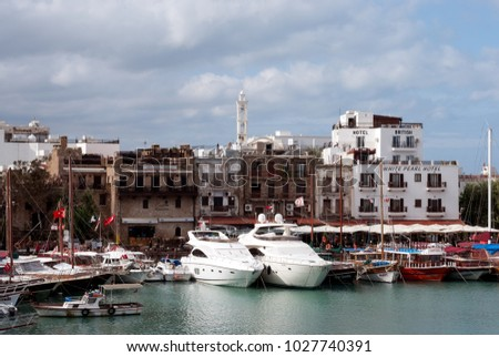 Kyrenia, Northern Cyprus - November 15, 2011: View on the yachts, small boats and hotels at the Kyrenia Harbour