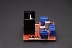 L298N Motor driver or motor controller board used in interface between motor and control circuits used to make electronic projects on black background
