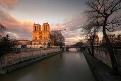 La Cathédrale Notre-Dame de Paris at the Seine river side in Paris, France.