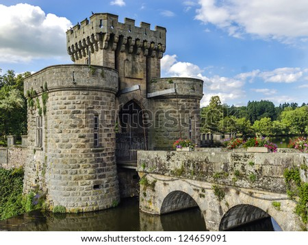 LA CLAYETTE, FRANCE - JULY 7: La Clayette castle drawbridge gates on July 7, 2012 in La Clayette, France. Gates are protecting south-east access to castle. They are surrounded by water ditch.