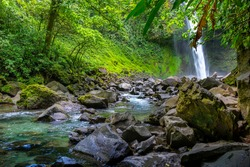 La Fortuna Waterfall in the forest with river, close to Arenal Volcano, Costa Rica national park. Central America.