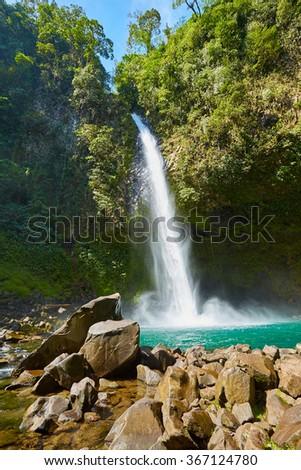 La Fortuna Waterfall, Waterfall with emerald pool in rainforest - Catarata Rio Fortuna, La Fortuna, Alajuela province, Costa Rica, Central America