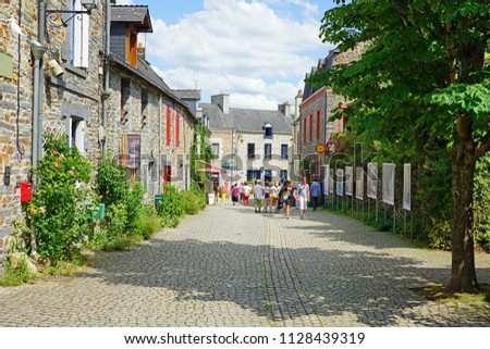 LA GACILLY, FRANCE -1 JUL 2018- View of La Gacilly, a town in Morbihan, Brittany, on the Aff River. Home to a photography festival, it is the headquarters of French cosmetics company Yves Rocher.  #1128439319