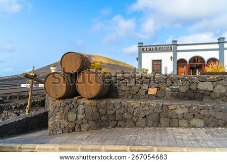 LA GERIA WINERY, LANZAROTE ISLAND - JAN 14, 2015: Wine oak barrels on terrace of winery in La Geria region of Lanzarote island. Grapes cultivated on volcanic soil are famous for their flavour.
