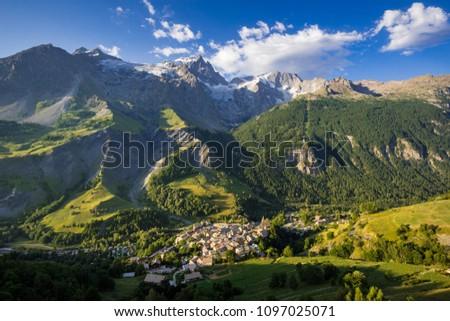 La Grave village with La Meije peak and glaciers in morning light. Ecrins National Park, Hautes-Alpes, French Alps, France #1097025071