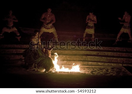 LA'IE, HI - JULY 26: Students perform the Samoan Fire-Dance at the Polynesian Cultural Center (PCC) July 26, 2008 in La'ie, HI. The PCC is Hawai'i top paid attraction and supports BYU students. - stock photo