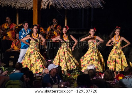 LA'IE, HI - NOVEMBER 21: Students perform Hawaiian cultural dances at the Polynesian Cultural Center (PCC) on November 21, 2012. The PCC is Hawai'i top paid attraction, and supports BYU students.
