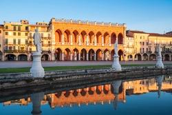 La Loggia Amuela Neogothic Palazzo on Prato della Valle Square in Padova, Veneto Region, Italy at Sunrise in the Morning with  Reflection in the Water