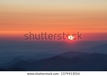 LA MONGIE, FRANCE - MARCH 19: shadows of the moutains during a sunrise in pyrenees region, Occitanie, La Mongie, France on March 19, 2018 in La Mongie, France.