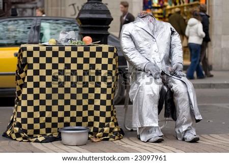 La Rambla, Barcelona, Spain. Street artist, scene of suicide